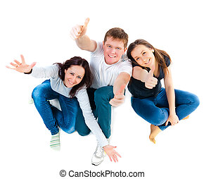 Top view of young friends sitting on the floor and showing...