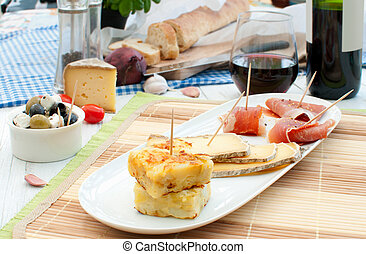 Spanish tapas - Platter consisting of potato omelette,...