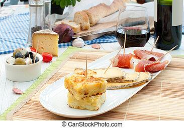 Spanish tapas - Platter consisting of potato omelette,...