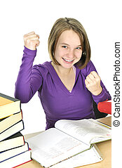 Teenage girl studying - Happy teenage girl studying at the...