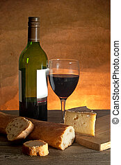 Cheese and wine - Glass of red wine with cheese and a sliced...