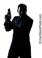 silhouette man portrait with gun - one caucasian spy...