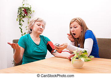 Nurse and patient are surprised by the blood pressure -...
