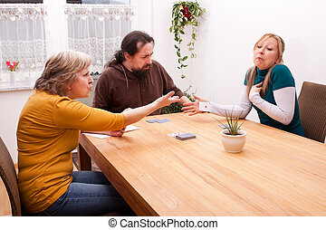 daughter cheating in card games with family - blond daughter...