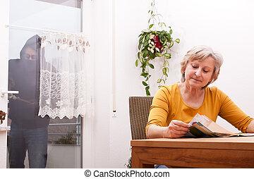 senior does not note the burglar - female senior does not...