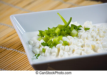 Bowl with fresh cottage cheese and chives