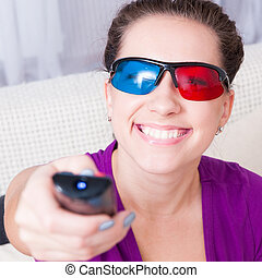 young girl watching 3d television