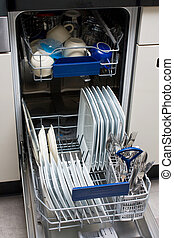 Dishwasher with white plates and steel cutlery