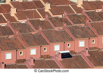 Roofs of red residential houses in a urbanization in Spain