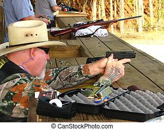 Gun Range - A retired marine shooting at an outdoor gun...