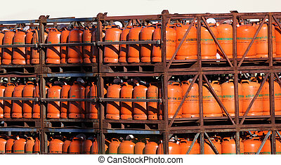 Propane gas bottles in a storage