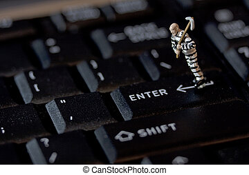 Internet Crime - Criminal with pick axe on keyboard