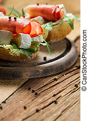Fresh sandwiches on a old wooden cutting board background 3
