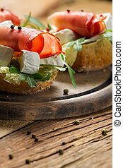 Fresh sandwiches on a old wooden cutting board background 6