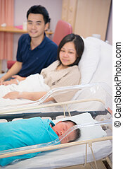 Asian Newborn and parents - Asian Newborn Infant Baby Girl...