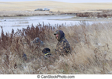 Hunter with his dog - Hunter waiting for ducks with his dog