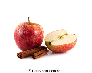 Isolated wet red apple with sliced half and cinnamon pods on...