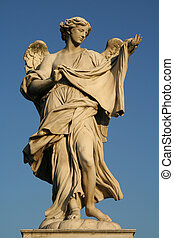 Low angle view of a statue - Low angle view of an angel...