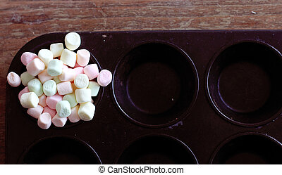 colorful marshmallows on black background