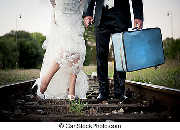 Wedding feet - Bride and groom are walking outside together