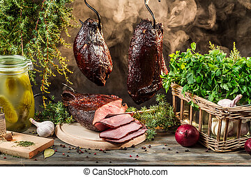 Smokehouse ham preparation for smoking in countryside