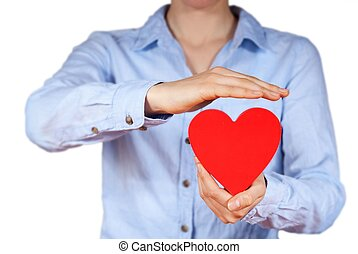 person holding a heart - a person holds a hand in its hands,...