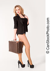 Sexy blonde woman on old suitcase