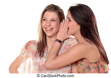 Gossip Girls - Two teenage girls gossiping and laughing