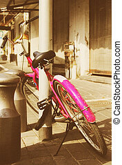 old pink bicycle. Photo in old image style.