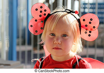 cute 2 years old girl dressed as a ladybug