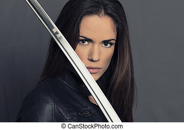 Portrait of beautiful girl with Katana in studio