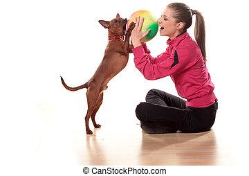 girl, dog and ball