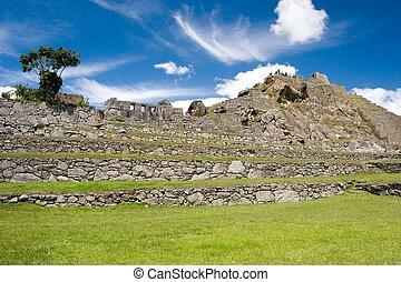 """Machu Picchu (Quechua: Machu Picchu, \\\""""Old Peak\\\"""") is a..."""
