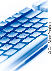computer keyboard in blue ambiance