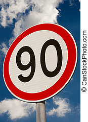 Speed Limit - Speed limit sign against a blue sky.