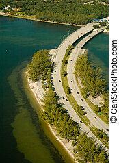 Causeway in the ocean - Aerial view of Rickenbacker Causeway...
