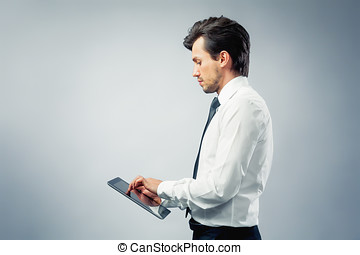 Businessman using a touchpad - Businssman working on a...