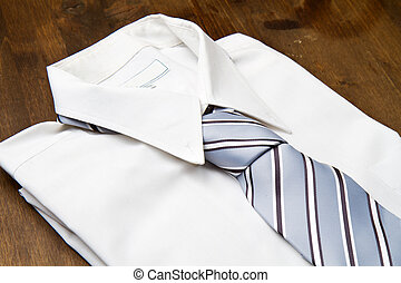 New white mans shirt and tie isolated on wood
