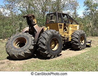 Logging skidder heavy equipment bulldozer used to snig cut...