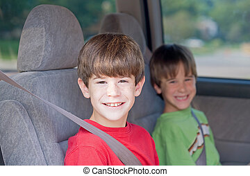 Boys in Car - Boys Buckled up in Automobile