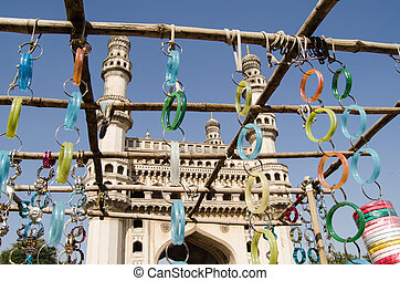 Bangles and Charminar - View looking through a market stall...