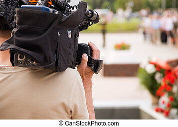 tv reportage - news cameraman, selective focus point on hand...