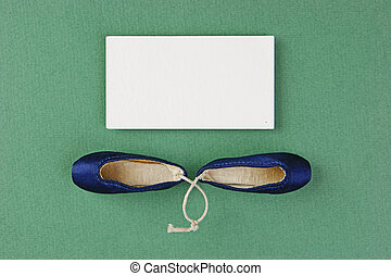 ballet slippers pointe gift and blank business card on the green background