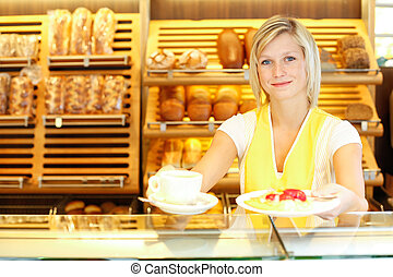 Shopkeeper in baker's shop preparing coffee and cake -...