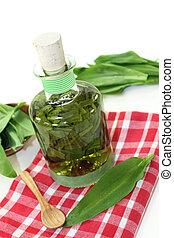 wild garlic tincture - a bottle garlic tincture on a white...