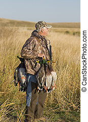 Duck Hunting - Hunter with a full strap of ducks