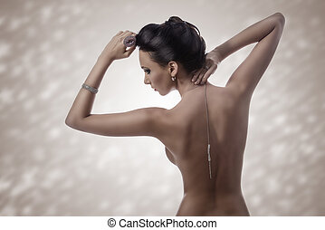 sexy woman showing her nude back - sensual naked brunette...