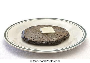 Potato pancake - Brown potato pancake with melting butter on...