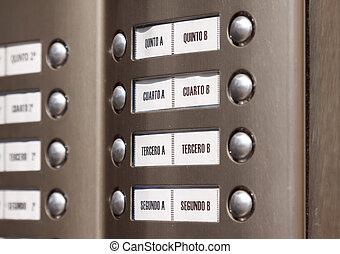 building intercom Apartment numbers in Spanish - Close-up of...