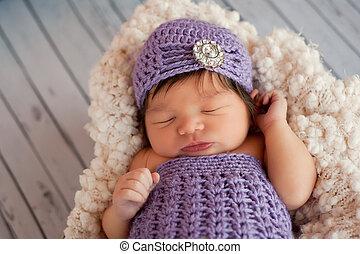 Newborn Baby Girl Wearing a Flapper - A portrait of a...